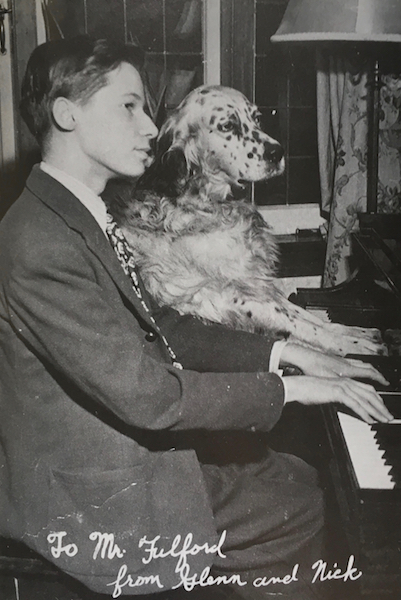 Glenn Gould and dog at piano
