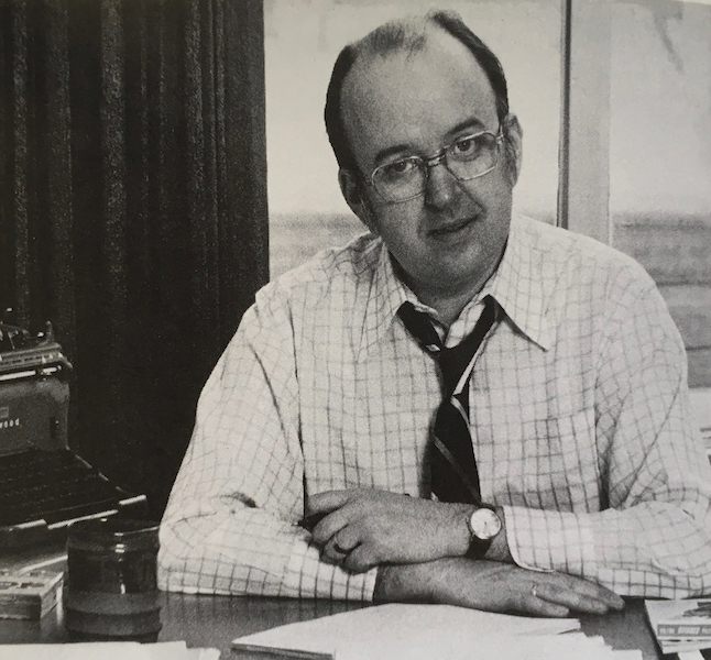 Robert Fulford at desk with typewriter