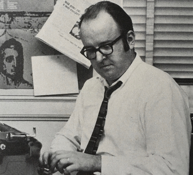 Robert Fulford using a typewriter