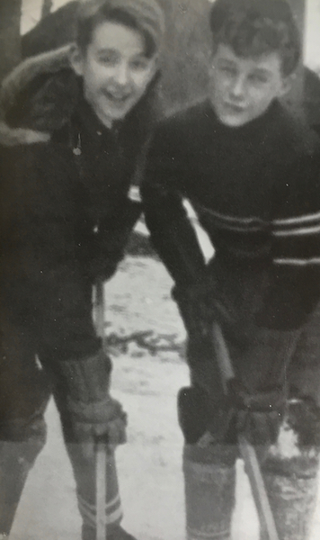 Robert Fulford and another boy, with hockey sticks