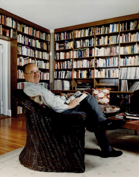 Robert Fulford in living room, with bookshelves
